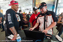 Checking in for a test ride at the Harley-Davidson display during Daytona Bike Week, FL, USA. March 8, 2014.  Photography ©2014 Michael Lichter.