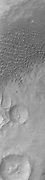 A large sandsheet with surface dune forms is shown in today's image of Aonia Terra.