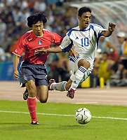 """11/08/04 - THESSALONIKI - GREECE -  -  FOOTBALL OLYMPIC MENS  -  First round Groupe A - <br />GREECE (2) V.s KOREA (2) at  THESSALONIKI """"KAFTATZOGLIO STADIUM"""" <br />Here KOREA N*2 CHOI WON KWON and Greece N*10 MITROU NIKOLAOS fighting for the ball.<br />© Gabriel Piko / Piko-Press"""