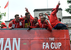 © Licensed to London News Pictures. 31/05/2015. <br /> LONDON, UK. The Arsenal FC first team and manager Arsene Wenger parade the FA Cup trophy through the streets of North London in an open top bus to celebrate winning the FA Cup yesterday, London, Sunday 31 May 2015. Photo credit : Hannah McKay/LNP