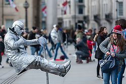 "© Licensed to London News Pictures. 17/02/2016. London, UK. Street entertainers, including living statues such as Star Wars' Yoda, and artists attract tourists outside the National Gallery in Trafalgar Square.  The National Gallery is objecting to their presence and would prefer the creation of ""one of London's great parks"" on the terrace instead to create a destination more suited to welcoming art lovers.  Westminster Council is considering bringing in a voluntary licensing scheme for the unlicensed performers. Photo credit : Stephen Chung/LNP"