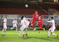 NEWPORT, WALES - Tuesday, October 16, 2018: Wales' Connor Evans goes up for a header during the UEFA Under-21 Championship Italy 2019 Qualifying Group B match between Wales and Switzerland at Rodney Parade. (Pic by Laura Malkin/Propaganda)