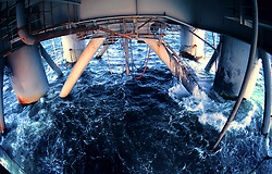 Stock photo of water churning under a semi submersible rig