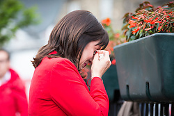 © Licensed to London News Pictures. 17/06/2016. Birstall UK. MP Rachel Reeves breaks down in tears at the scene in Birstall market place this morning where MP Jo Cox was murdered yesterday. Photo credit: Andrew McCaren/LNP