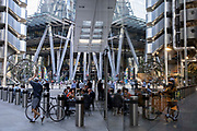 In the week that many more Londoners returned to their office workplaces after the Covid pandemic, businesspeople gather to enjoy after-hours drinks beneath the Lloyds Building (left) and other modern skyscrapers on Leadenhall in the City of London, the capital's financial district, on 8th September 2021, in London, England.