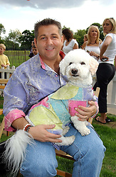 ERIC WAY and his dog Storm  at the Macmillan Cancer Relief Dog Day held at the Royal Hospital Chelsea South Grounds, London on 6th July 2004.