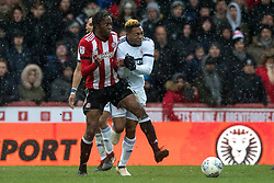 Brentford's Romaine Sawyers fouls Middlesbrough's Adama Traore and is subsequently sent off after receiving a second yellow card