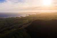Aerial view of scenic sunset over Purakaunui Bay, New Zealand.