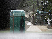 A guard holds his post while dodging the rain underneath a shelter at the Plaza del Servicio a la Patria during a rainy season downpour in Mexico City, Friday, July 1, 2016. The  Plaza del Servicio a la Patria acts as an Armed Forces Memorial and was dedicated in 2013. NICK WAGNER / ASSOCIATED PRESS