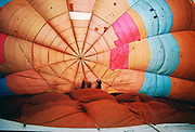 Hot air balloon being deflated and pulled to the ground, Dunstable Downs, Bedfordshire, UK RESERVED USE - NOT FOR DOWNLOAD -  FOR USE CONTACT TIM GRAHAM