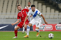 ATHENS, GREECE - OCTOBER 11: Dimitris Limniosof Greece and Oleg Reabciukof Moldova during the UEFA Nations League group stage match between Greece and Moldova at OACA Spyros Louis on October 11, 2020 in Athens, Greece. (Photo by MB Media)