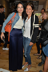 Left to right, YASMIN MILLS and AVERYL OATES at a party to celebrate the launch of Top Dog at 48 Frith Street, Soho, London on 27th May 2015