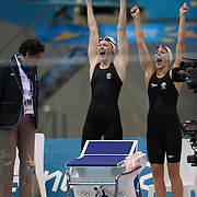 Cate Campbell (left)  and Alicia Coutts celebrate with Melanie Schlanger (in pool) as  he Australian team win the gold medal in the women's 4 x 100m freestyle relay final during the swimming finals at the Aquatic Centre at Olympic Park, Stratford during the London 2012 Olympic games. London, UK. 28th July 2012. Photo Tim Clayton