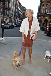 RUTH FITZGIBBONS and her dog Romeo at the 10th anniversary of George in association with The Dog's Trust held at George, 87-88 Mount Street, Mayfair, London on 13th September 2011.