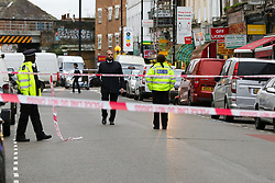 © Licensed to London News Pictures. 30/10/2020. London, UK. Police officers guard a crime scene on West Green Road in Tottenham, north London, following the stabbing of a man in his 20s. Photo credit: Dinendra Haria/LNP