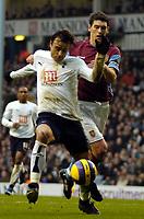 Photo: Ed Godden.<br /> Tottenham Hotspur v Aston Villa. The Barclays Premiership. 26/12/2006. Spurs' Dimitar Berbatov is held back by Aston Villa Captain Gareth Barry.