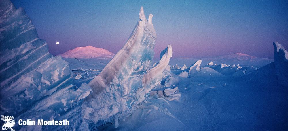 Moon rise over Mt Erebus, pressure ridges on sea ice in front of New Zealand's Scott base, Ross Island, Antarctica.