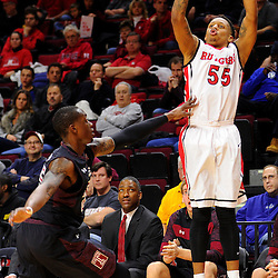 D'Von Campbell #55 of the Rutgers Scarlet Knights takes a shot over Quenton DeCosey #25 of the Temple Owls during the first half of Rutgers men's basketball vs Temple Owls in American Athletic Conference play on Jan. 1, 2014 at Rutgers Louis Brown Athletic Center in Piscataway, New Jersey.