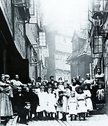 Occupants of a street in the working quarter of Hamburg, Germany, 1901.