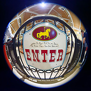 Garden City, New York, USA. March 9, 2019. ENTER sign, seen in fisheye lens view, is on entrance gate to Nunley's Carousel, where riders enjoy free rides during Unveiling Ceremony of mural by painter Michael White, held at historic Nunley's Carousel in its Pavilion on Museum Row on Long Island.