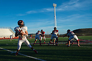 Iraan High School quarterback Clayton Kent #11 drops back to pass during practice on in Iraan, Texas on December 13, 2016. (Cooper Neill for The New York Times)