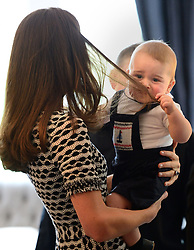 The Duchess of Cambridge and Prince George meet parents and babies during a visit to Plunket, a child welfare group at Government House, Wellington, during their official tour to New Zealand.