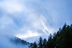 Clearing storm at the Matterhorn in Zermatt Switzerland. This mountain live in a cloud as most extremely tall peaks do. It is a joy to be there when one comes out of hiding.