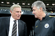 Trevor Brooking and Brian Kidd, the Manchester City assistant manager (r) talking before k.o. Premier league match, West Ham Utd v Manchester city at the London Stadium, Queen Elizabeth Olympic Park in London on Wednesday 1st February 2017.<br /> pic by John Patrick Fletcher, Andrew Orchard sports photography.