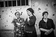 Ossetian women look at Europe Commissioner for Human Rights, Thomas Hammarberg visiting their village. Khetagurovo, August 24, 2008 .