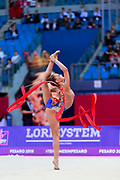Averina Arina during the final at ribbon in Pesaro World Cup 15 April, 2018. Arina is a Russian gymnast born in Zavolž'e on 13 August 1998. She is the 2017 World All-around silver medalist. Her twin sister Dina Averina, also a rhythmic gymnastics athlete.
