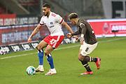 Fussball: 2. Bundesliga, FC St. Pauli - Hamburger SV, Hamburg, 01.03.2021<br /> Josha Vagnoman (HSV), l.) - Rodrigo Zalazar (Pauli)<br /> © Torsten Helmke
