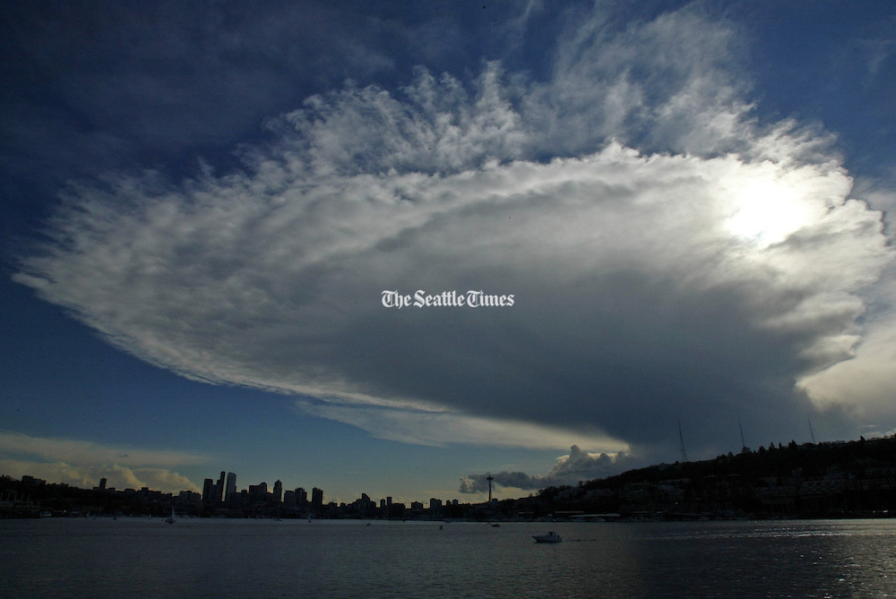 An unusual cloud formation loomed over Seattle in this view taken looking south toward the downtown skyline from Gas Works Park. (Greg Gilbert / The Seattle Times)