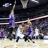 06 March 2017: Denver Nuggets forward Darrell Arthur (00) eyes the basket as Sacramento Kings center Willie Cauley-Stein (00) jumps next to Sacramento Kings forward Skal Labissiere (3) during the Denver Nuggets 108-96 victory over the Sacramento Kings, at the Pepsi Center, Denver, Colorado, USA.