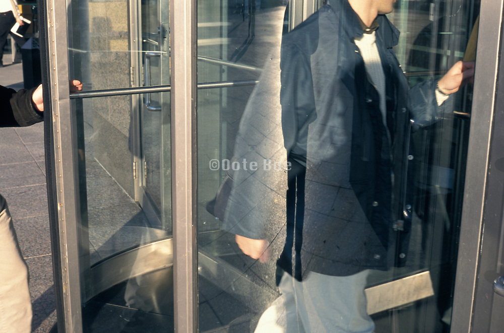 2 men entering an office building
