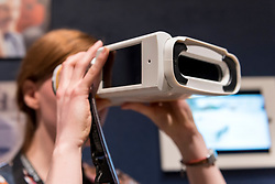 """© Licensed to London News Pictures. 11/09/2018. LONDON, UK. A staff member tests """"Quicksee"""", designed by PlenOptika, a portable eye test device for use in developing countries, at a preview of the 87 nominees for the eleventh Beazley Designs of the Year exhibition and awards at the Design Museum in Kensington.  The exhibition runs 12 September to 6 January 2019 and celebrates the most innovative designs of the last year.  Photo credit: Stephen Chung/LNP"""