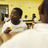 Jajuan reacts to his friend Deshazio Williams at the lunch table.
