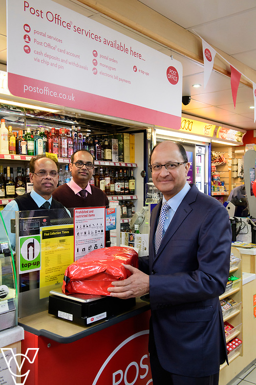 Shailesh Vara MP is served at the counter of Matley Post Office by Subramaniam Nithythasan, left, and Subramaniam Nithaharan<br /> <br /> Shailesh Vara MP has cut the ribbon to official opening of the brand new Matley Post Office, part of the Londis Store, Matley, Orton Brimbles, Peterborough. The store is owned by Subramaniam Nithythasan and Subramaniam Nithaharan.<br /> <br /> Date: April 5, 2019