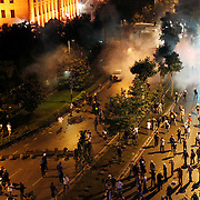 Turkish riot police use tear gas to disperse activists from the Gezi Park in Istanbul, Turkey, late 15 June 2013. Turkish riot police are firing water cannons and tear gas at protesters in Istanbul's Gezi Park, witnesses said on Saturday, hours after Prime Minister Recep Tayyip Erdogan vowed to remove them from the disputed public space by force. Protesters had earlier vowed to continue occupying the park, despite having reached a deal with the government on plans to redevelop it. Photo by AYKUT AKICI/TURKPIX