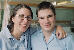 Student nurses on medical ward smiling,