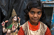 Portrait of a local girl. Kumartuli is the colourful traditional potters' quarter in northern Kolkata (formerly Calcutta). Calcutta is the capital of India's West Bengal state. Founded as an East India Company trading post, it was India's capital under the British Raj from 1773–1911.