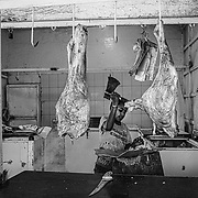KHARTOUM, SUDAN - DECEMBER 11: A boy butchers meat for customers at a corner store in Khartoum, Sudan on December 11, 2020. Byron Smith for Libération