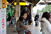 Woman with her mobile phone at a subway station in Tokyo. Tokyo has 13.01 million inhabitans, is the Japanese capital and the largest city in Japan. Tokyo, Japan, 23.10 2010.