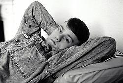 Young man in homeless hostel, Nottingham UK 1989