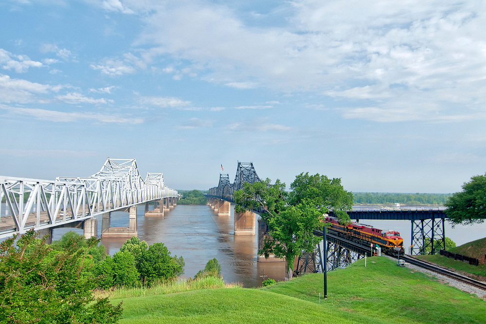 A tug boat passes travels the river whil a train crosses the bridge in Vicksburg, Mississippi on Monday, May 21, 2018. Copyright 2018 Jason Barnette