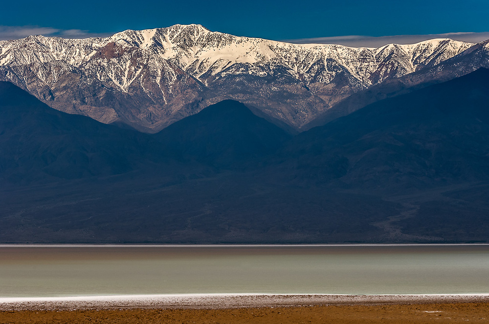 Badwater Basin, lowest elevation in the United States, 282 feet below sea level (−86.0 m), morning light, April, Telescope Peak 11,043 feet (3,366 m) in the distance, Panamint Range Death Valley National Park, California, USA