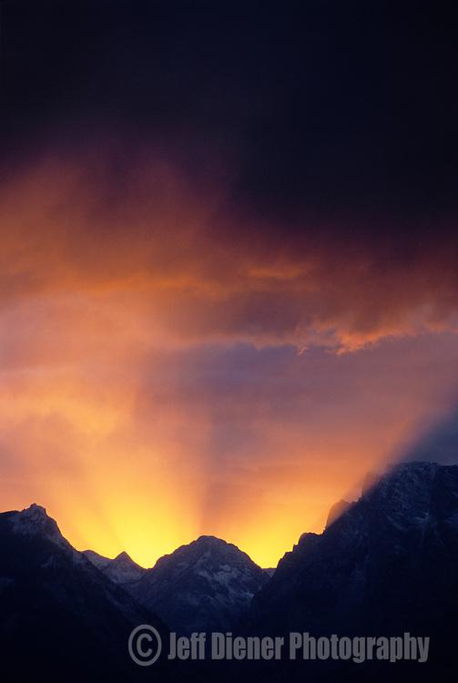 A dramatic sunset lights the clouds above the northern Teton Range, Grand Teton National Park, Jackson Hole, Wyoming.