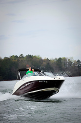 20120316 LAKE NORMAN MAGAZINE - Mark and Amanda Zeaser, members of the Carefree Boat Club of Lake Norman brought their friends, Will and Jessica Banias out in a Sea Ray Sundeck 240 for a day on the lake.<br />      Marc and Oana Graveline opened the Carefree Boat Club of Lake Norman in May, 2010.  <br />      Boat clubs allow members the joy of boating without the expenses and responsibilities of ownership. Depending on the boat club, members pay a one time joining fee and monthly dues for unlimited access to the club's fleet.<br /> photo by Laura Mueller <br /> www.lauramuellerphotography.com
