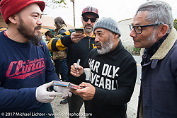 A fan gets Legendary skate boarder Steve Caballero to sign an original 1970's VHS skateboarding video on the Blue Groove shop ride from Kamakura to Miura Penninsula. Japan. Monday December 4, 2017. Photography ©2017 Michael Lichter.