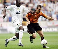Photo:  Frances Leader.<br /> Wolverhampton Wanderers FC v Leeds United. The Coca-Cola Championship Molineux Stadium.<br /> 14/08/2004<br /> Wolves' Lee Naylor battles it out with Leeds'