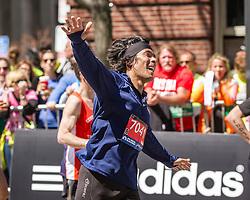 2014 Boston Marathon: elated runner heading for the finish line